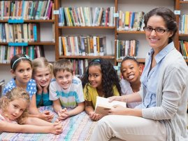 librarian with kids in library